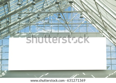 Blank signboard in front of the glass roof of the shopping center