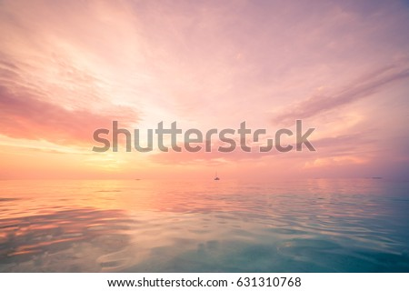 Inspirational calm sea with sunset sky. Meditation ocean and sky background. Colorful horizon over the water