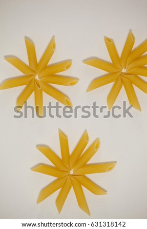 Flowers formed of pennette pasta on white background #631318142