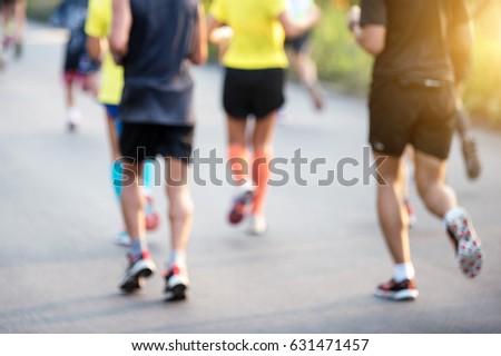 blurred mass of marathon runners #631471457