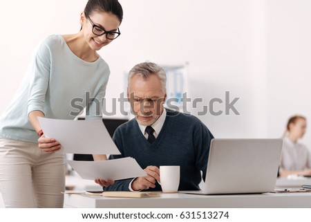 Attractive brunette standing near table of her boss #631513274