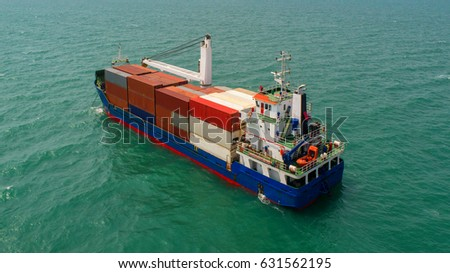 container,container ship in import export and business logistic,By crane ,Trade Port , Shipping,cargo to harbor.Aerial view,Water transport,International,Shell Marine,transportation,logistic #631562195