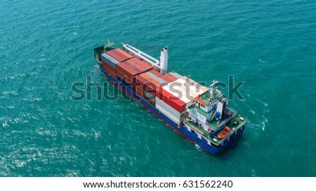 container,container ship in import export and business logistic,By crane ,Trade Port , Shipping,cargo to harbor.Aerial view,Water transport,International,Shell Marine,transportation,logistic #631562240