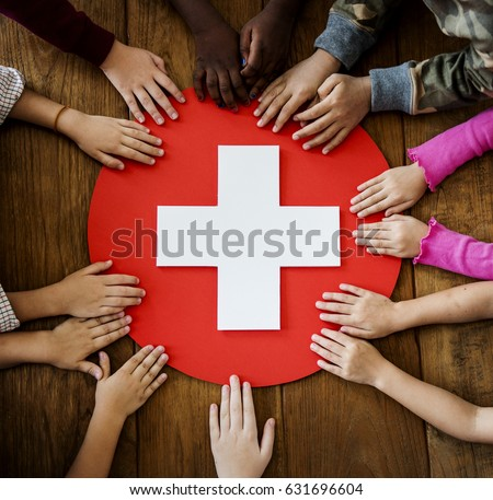 Group of children hands holding red cross symbol #631696604