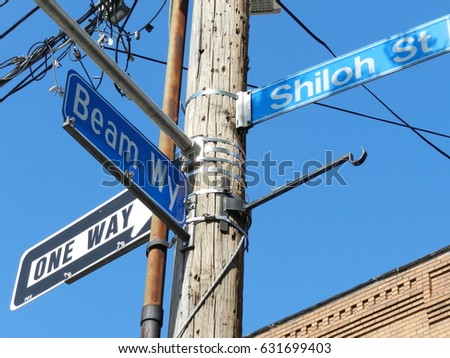 Blue street signs corner of Beam Way and Shiloh Street with traffic sign one way #631699403
