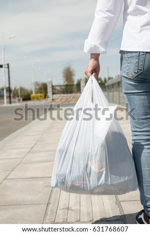 Woman holding a plastic bag #631768607