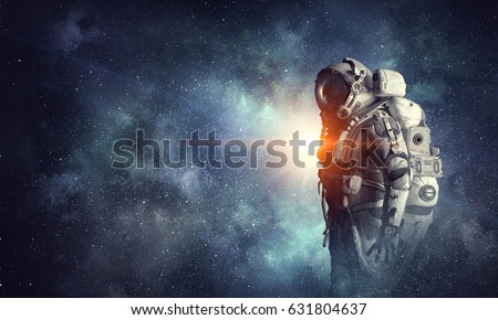 Astronaut in outer space. Mixed media Royalty-Free Stock Photo #631804637