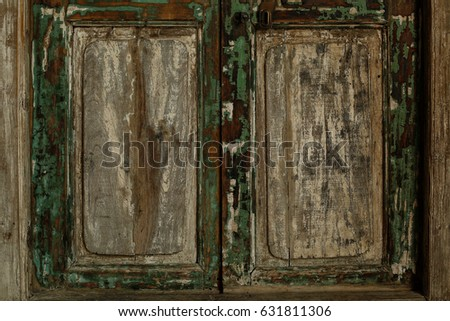 Close up of retro wood or wooden window frames view isolated on house wall on old vintage background #631811306