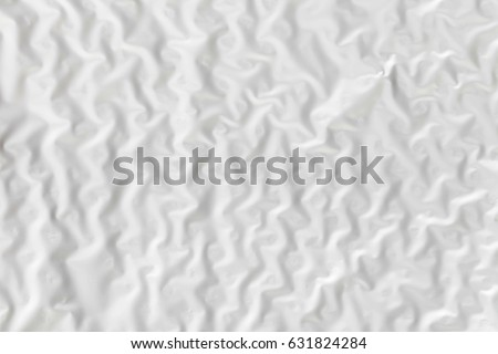 Abstract background texture of white wrinkled paper close-up #631824284