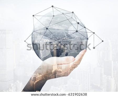 Close up of hand holding abstract globe with connections on city background. Global business concept. Double exposure Royalty-Free Stock Photo #631902638
