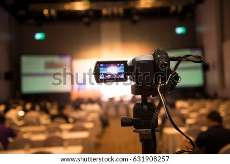 video camera in business conference room recording participants and speaker #631908257