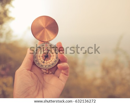 woman hold compass in nature background for journey trip Royalty-Free Stock Photo #632136272