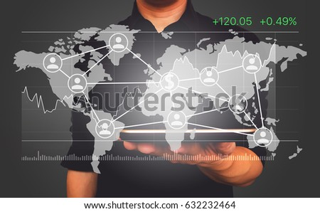 Tablet on businessman in black shirt with world map, data report graph and business connections for business and financial concept. #632232464