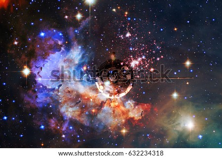Spaceship in outer space against the background of the nebula. Elements of this image furnished by NASA. #632234318