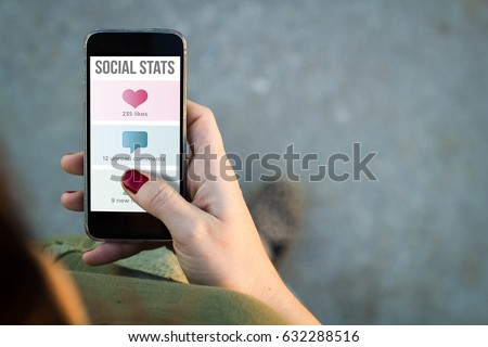 Top view of woman walking in the street using her mobile phone with copy space. All screen graphics are made up. #632288516