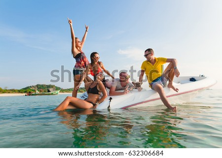 hipster company of friends having fun together on boat in sea, summer vacation, smiling, positive, traveling around world, sunny, Thailand, sunglasses, cool people, party #632306684