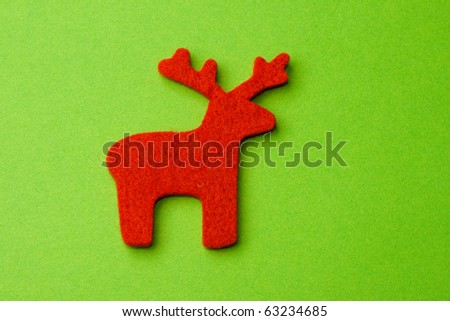 Reindeer isolated on the green background.