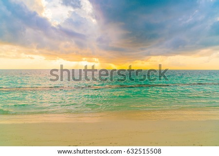 Beautiful sunset with sky over calm sea  in tropical Maldives island #632515508