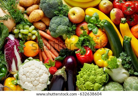 Different colorful fruits and vegetables all over the table in full frame studio shot #632638604