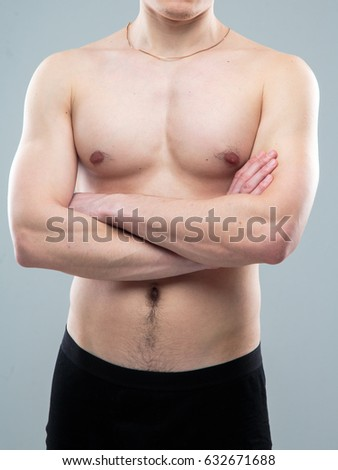 Man with sport figure, naked torso #632671688