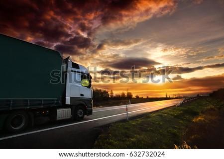 Truck transportation at sunset #632732024