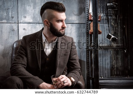 Brutal bearded man with beard posing, drinking whiskey #632744789
