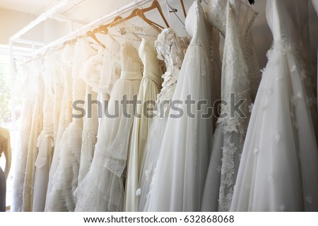 Beautiful bridal dress on hangers Royalty-Free Stock Photo #632868068