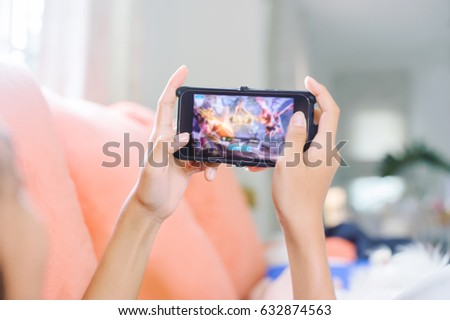 young girl playing games on line in home  #632874563