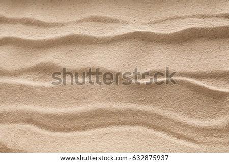 Beach wavy sand background. Natural seashore texture surface, closeup #632875937