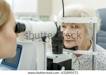 Young female ophthalmologist using apparatus #632890571