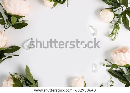 Empty space surrounded with flowers, top view faux peonies. Wedding invitation, floral background. #632938643