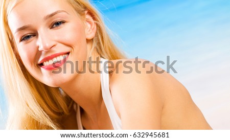 Portait of happy smiling cheerful young beautiful blond woman on the beach #632945681