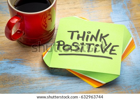 think positive - inspirational handwriting in a green sticky note with a cup of coffee Royalty-Free Stock Photo #632963744