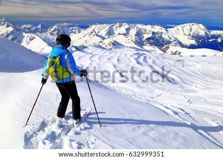Woman skier sliding off piste in stormy weather, Les Deux Alpes, France #632999351