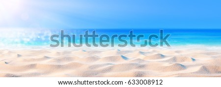Sand Background With Sea And Sunlight  #633008912