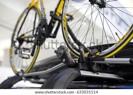 Detail of the bicycle on the roof bike rack Royalty-Free Stock Photo #633031514