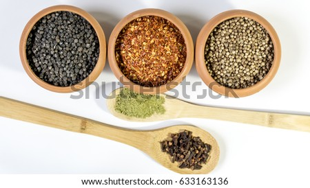 Sri Lankan Spices/ Cloves, Curry Leaves Powder, pepper, coriander seeds and Chillies isolated on white background #633163136