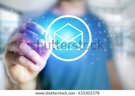 View of a Man drawing an email icon on a futuristic interface - Technology concept #633302378