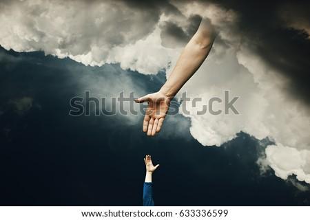 Helping Hand of God Mercy Royalty-Free Stock Photo #633336599