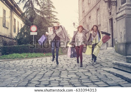 Young female best friends doing shopping on the streets. #633394313