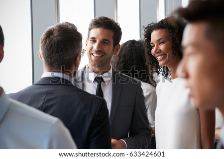Group Of Businesspeople Having Informal Office Meeting Royalty-Free Stock Photo #633424601