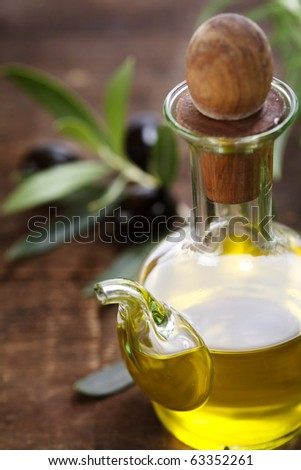 bottle of olive oil  and an olive branch #63352261