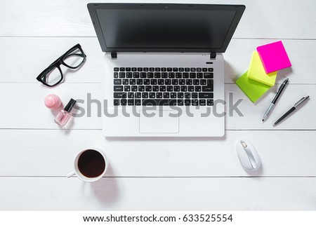 Workspace with laptop, green flower in a pot, mint diary on white background. #633525554