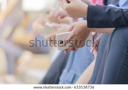 Background blur of people group holding smart phone and spending time on line outdoor,selective focus,copyspace.  #633538736