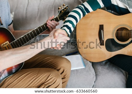 Learning to play the guitar. Music education and extra-curricular lessons. #633660560