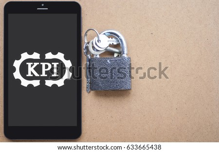 Key Performance Indicator (KPI) Service Business planning web tablet computer concept. Strategy security success conception. Safety plan template for text on wood background. Evaluation mobile metrics