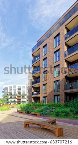 Vilnius, Lithuania - October 1, 2016: Benches at Modern architectural complex of apartment residential buildings. And outdoor facilities. #633707216