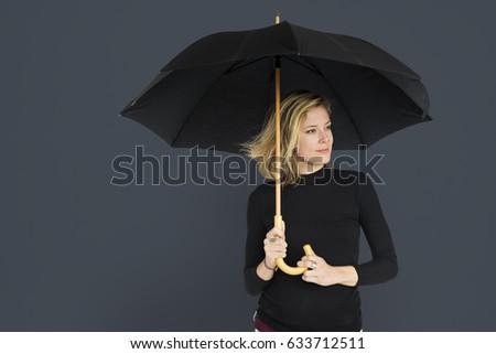 Caucasian Lady Black Umbrella Concept #633712511
