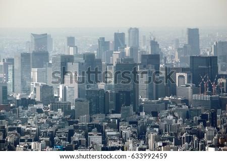 Tokyo city, Japan. Hazy skyline of Marunouchi district. #633992459