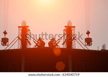 silhouette construction team working on high ground over blurred background sunset pastel for industry background. #634040759
